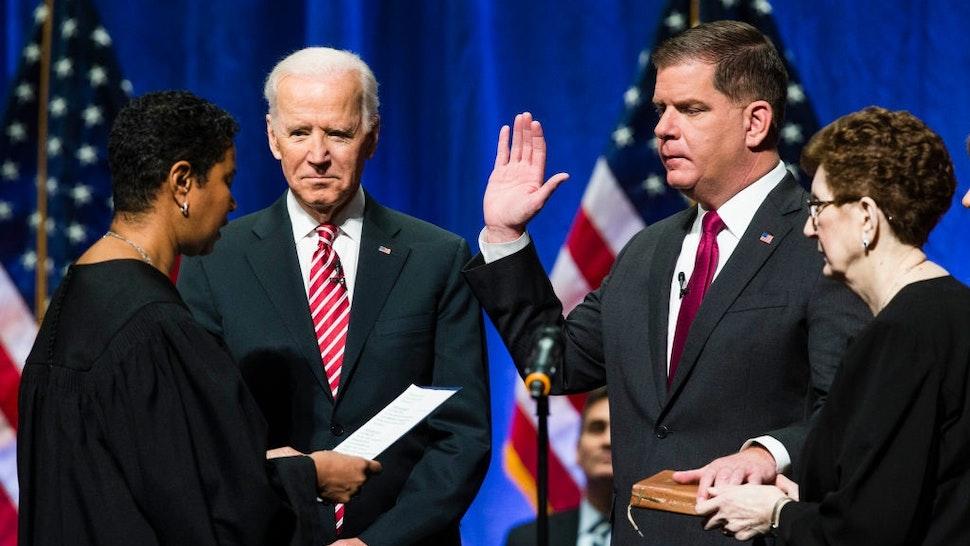 BOSTON, MA - JANUARY 2: Former U.S. Vice President Joe Biden watchers as Boston Mayor Martin J. Walsh is sworn in during his second inauguration in Boston on Jan. 2, 2018.