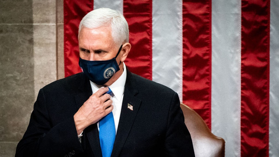 WASHINGTON, DC - JANUARY 06: Vice President Mike Pence presides over a joint session of Congress on January 6, 2021 in Washington, DC. Congress has reconvened to ratify President-elect Joe Biden's 306-232 Electoral College win over President Donald Trump, hours after a pro-Trump mob broke into the U.S. Capitol and disrupted proceedings. (Photo by Erin Schaff - Pool/Getty Images)