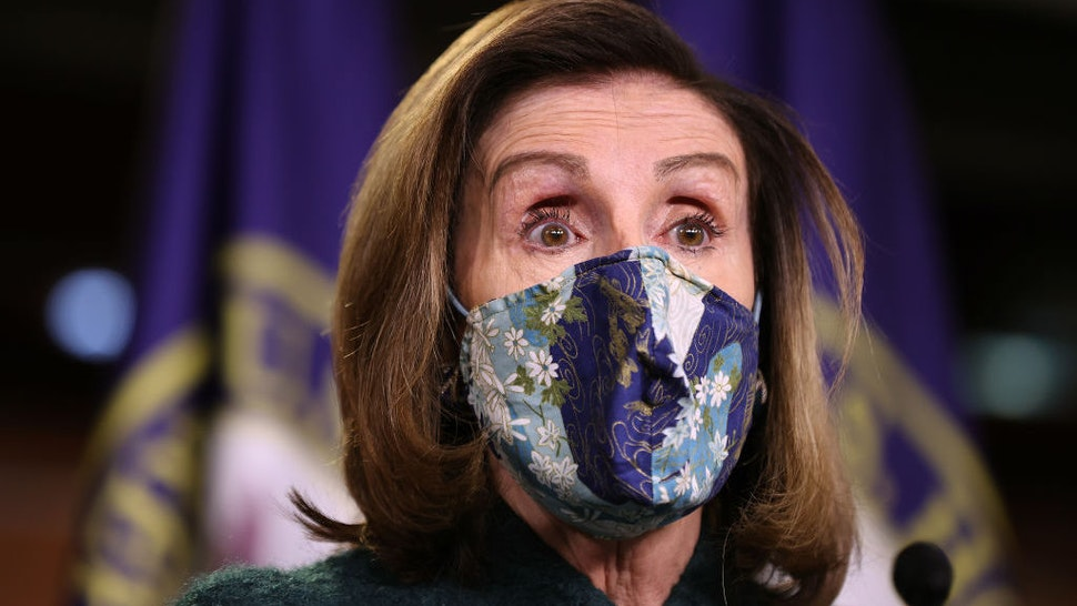 WASHINGTON, DC - JANUARY 28: Wearing a face mask to reduce the risk posed by the novel coronavirus pandemic, Speaker of the House Nancy Pelosi (D-CA) holds her weekly news conference in the U.S. Capitol Visitors Center January 28, 2021 in Washington, DC. When asked about what she means when she said Congress has an 'enemy within,' Pelosi said, 'It means that we have members of Congress who want to bring guns on the floor and have threatened violence on other members of Congress.' (Photo by Chip Somodevilla/Getty Images)