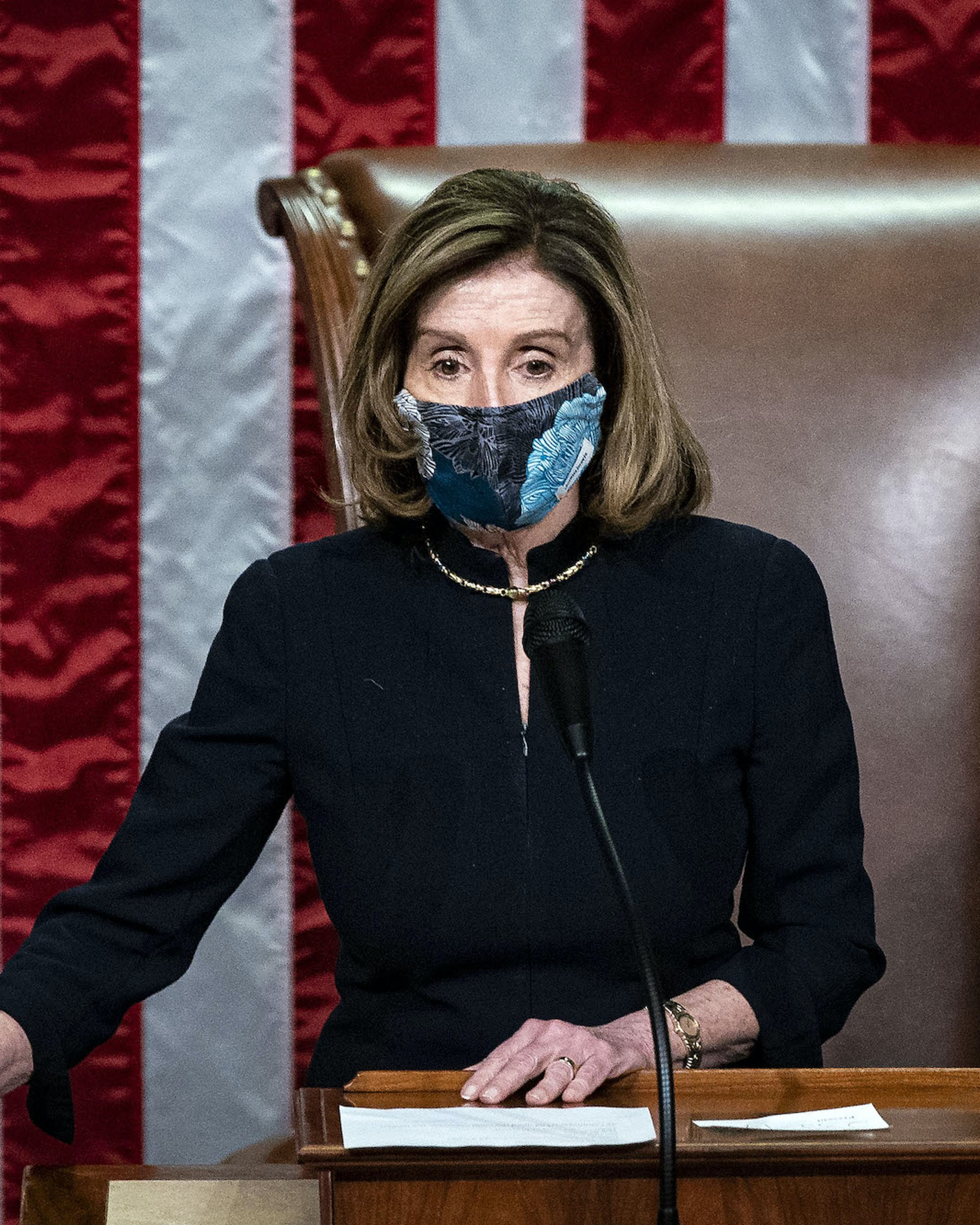 U.S. House Speaker Nancy Pelosi, a Democrat from California, wears a protective mask while banging the Speaker's gavel on the floor of the House at the U.S. Capitol in Washington, D.C., U.S., on Wednesday, Jan. 13, 2021. President Donald Trump was impeached by the U.S. House on a single charge of incitement of insurrection for his role in a deadly riot by his supporters that left five dead and the Capitol ransacked, putting an indelible stain on his legacy with only a week left in his term. Photographer: Al Drago/Bloomberg