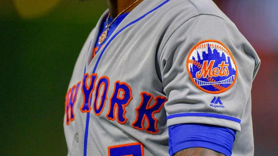 PHILADELPHIA, PA - AUGUST 16: The New York Mets logo across the might arm of New York Mets shortstop Jose Reyes (7) during the MLB game between the New York Mets and the Philadelphia Phillies on August 16, 2018 at Citizens Bank Park in Philadelphia PA.