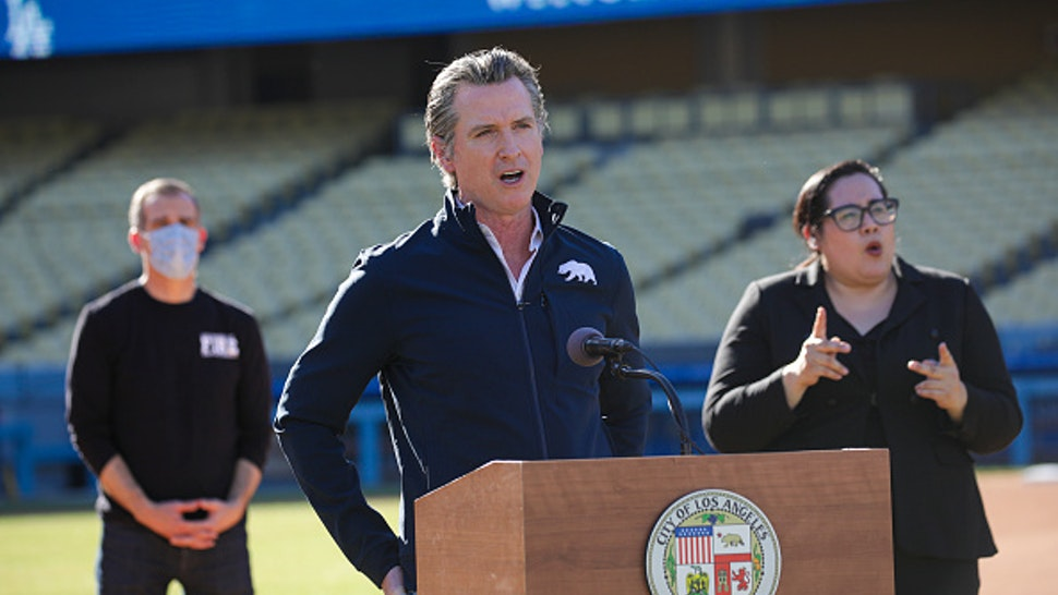 California Governor Gavin Newsom addresses a press conference held at the launch of mass Covid-19 vaccination site at Dodger Stadium on January 15, 2021 in Los Angeles, California.