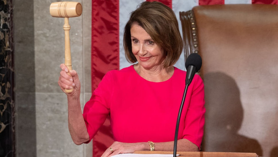 Incoming Speaker of the House Nancy Pelosi holds her gavel after being elected during the beginning of the 116th US Congress at the US Capitol in Washington, DC, January 3, 2019. - Pelosi was elected speaker of the House Thursday for the second time in her political career, a striking comeback for the only woman ever to hold the post. (Photo by SAUL LOEB / AFP)