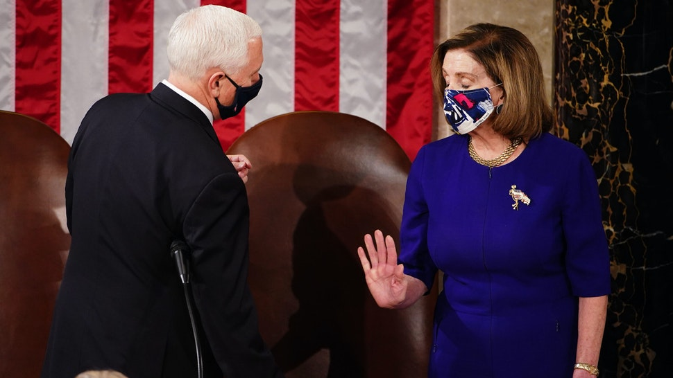 WASHINGTON, DC - JANUARY 06: U.S. Vice President Mike Pence and Speaker of the House Nancy Pelosi (D-CA) attend a joint session of Congress on January 06, 2021 in Washington, DC. Congress held a joint session today to ratify President-elect Joe Biden's 306-232 Electoral College win over President Donald Trump. A group of Republican senators said they would reject the Electoral College votes of several states unless Congress appointed a commission to audit the election results.