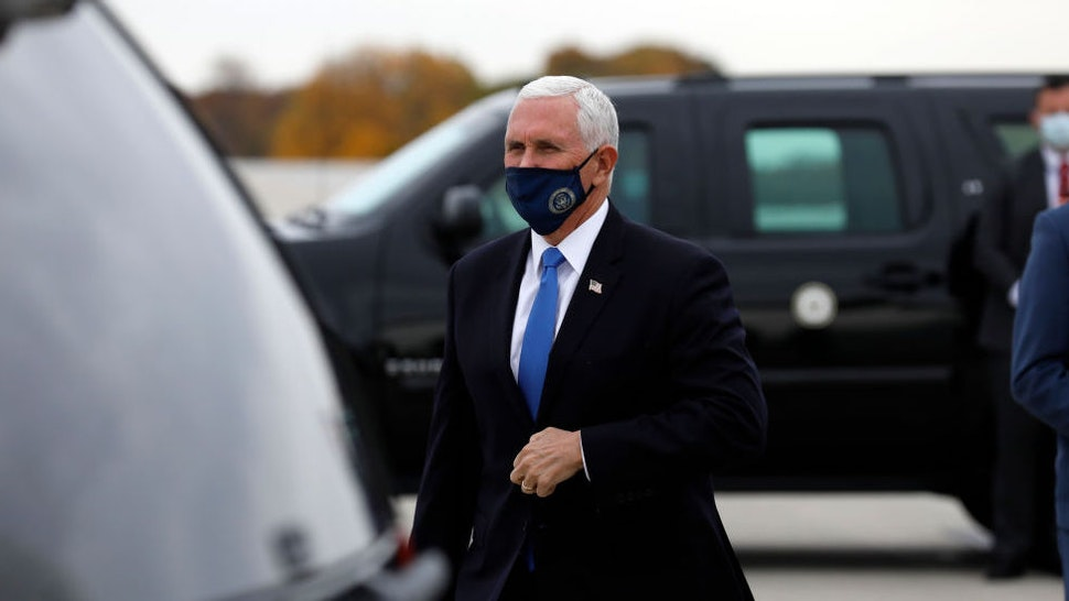 US Vice President Mike Pence arrives at Gerald Ford Airport in Grand Rapids, Michigan, on October 14, 2020. (Photo by JEFF KOWALSKY / AFP)