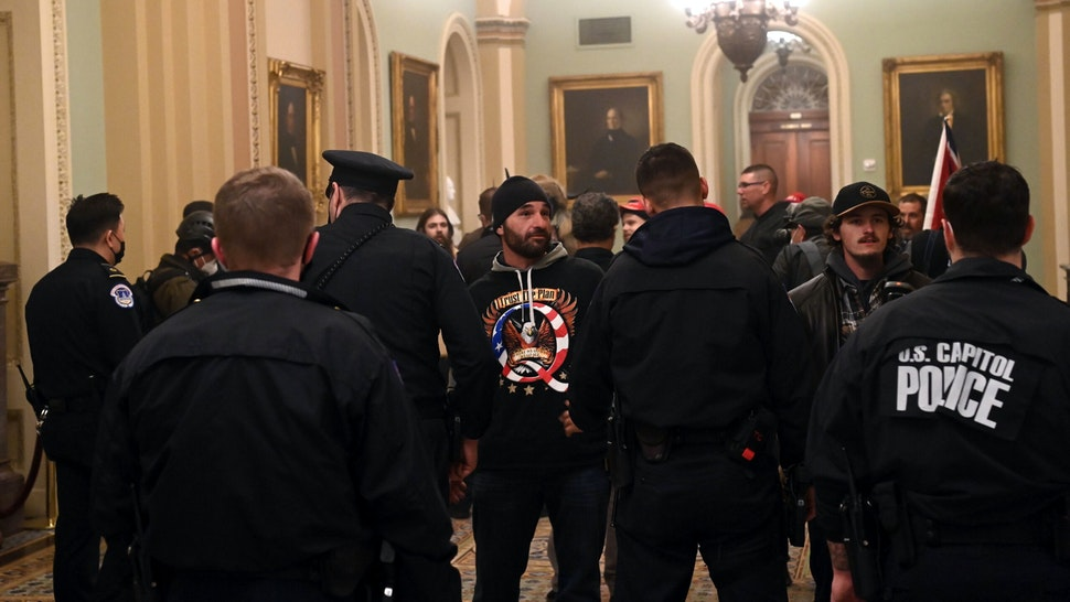 Supporters of US President Donald Trump enter the US Capitol on January 6, 2021, in Washington, DC. - Demonstrators breeched security and entered the Capitol as Congress debated the a 2020 presidential election Electoral Vote Certification.