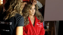 NEW YORK, NEW YORK - FEBRUARY 05: Sunny Hostin prepares backstage at The American Heart Association's Go Red for Women Red Dress Collection 2020 at Hammerstein Ballroom on February 05, 2020 in New York City. (