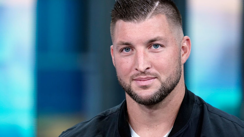 """NEW YORK, NEW YORK - OCTOBER 09: Professional baseball player Tim Tebow visits """"Fox & Friends"""" at Fox News Channel Studios on October 09, 2019 in New York City."""