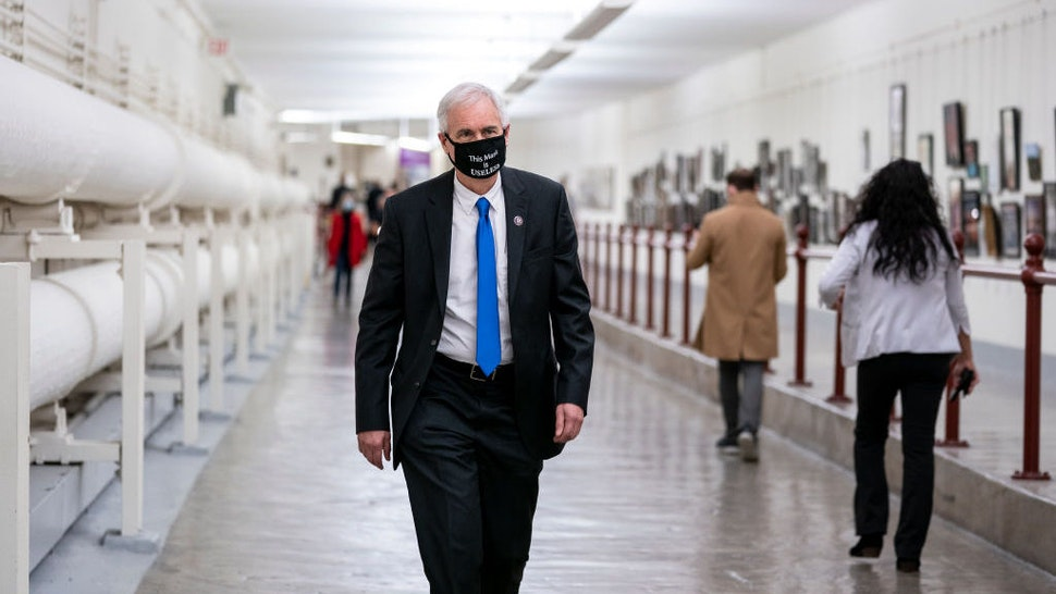WASHINGTON, DC - JANUARY 12: Rep. Tom McClintock (R-CA) wears a protective mask while walking through the Canon Tunnel to the U.S. Capitol on January 12, 2021 in Washington, DC. Today the House of Representatives plans to vote on Rep. Jamie Raskin's (D-MD) resolution calling on Vice President Mike Pence to invoke the 25th Amendment, removing President Trump from office. On Wednesday, House Democrats plan on voting on articles of impeachment. (Photo by Stefani Reynolds/Getty Images)