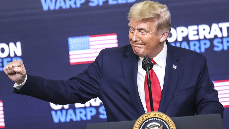 U.S. President Donald Trump gestures during an Operation Warp Speed vaccine summit at the White House in Washington, D.C., U.S., on Tuesday, Dec. 8, 2020. Trumpcelebrated the development of coronavirus vaccines at a White House summit on Tuesday and vowed to use executive powers if necessary to acquire sufficient doses, as the number of U.S. cases surpassed 15 million.