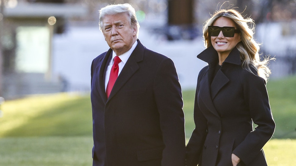 WASHINGTON, DC - DECEMBER 23: President Donald Trump and first lady Melania Trump walk on the south lawn of the White House on December 23, 2020 in Washington, DC. The Trumps are headed to Mar-a-Lago for the holidays with a government shutdown possible on Monday December 28.