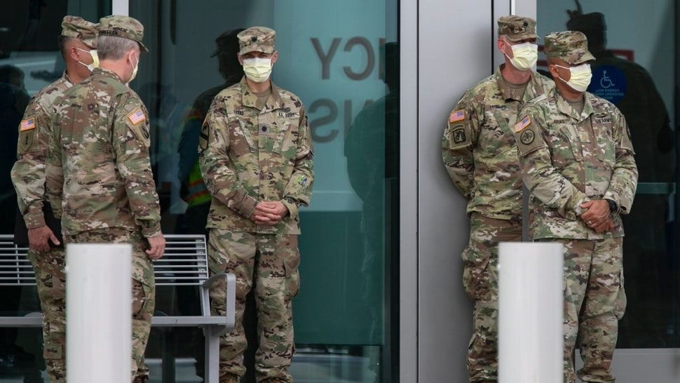 MIAMI BEACH, FL - APRIL 8: Members of the U.S. Army Corps of Engineers stand outside the Miami Beach Convention Center as they build a coronavirus field hospital inside the facility on April 8, 2020 in Miami Beach, Florida.