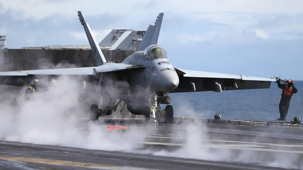 AT SEA, UNITED KINGDOM - AUGUST 06: An F/A-18 Hornet prepares for take off during joint military exercise, Saxon Warrior, aboard the USS George H.W. Bush on August 6, 2017 off the north west coast of the United Kingdom. The American Aircraft carrier the USS George HW Bush is a nuclear powered 97,000-tonne, 20 story high Nimitz class aircraft carrier. It has a 4.5-acre flight deck with around 80 combat aircraft and is home to around 5,000 US Navy personnel who are currently conducting joint military exercises off the coast of the United Kingdom.
