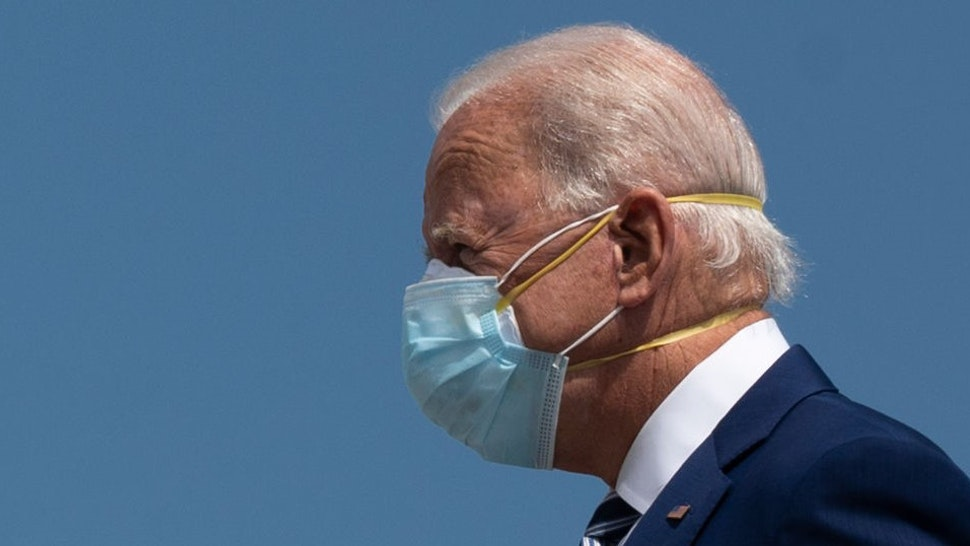 """Democratic Presidential Candidate Joe Biden wears two masks as he arrives in Fort Lauderdale, Florida on October 13, 2020. - Joe Biden headed for Florida on Tuesday to court elderly Americans who helped elect Donald Trump four years ago but appear to be swinging to the Democratic candidate for the White House this time around amid the coronavirus pandemic. Biden, at 77 the oldest Democratic nominee ever, is to """"deliver his vision for older Americans"""" at an event in the city of Pembroke Pines, north of Miami, his campaign said. (Photo by JIM WATSON / AFP) (Photo by"""