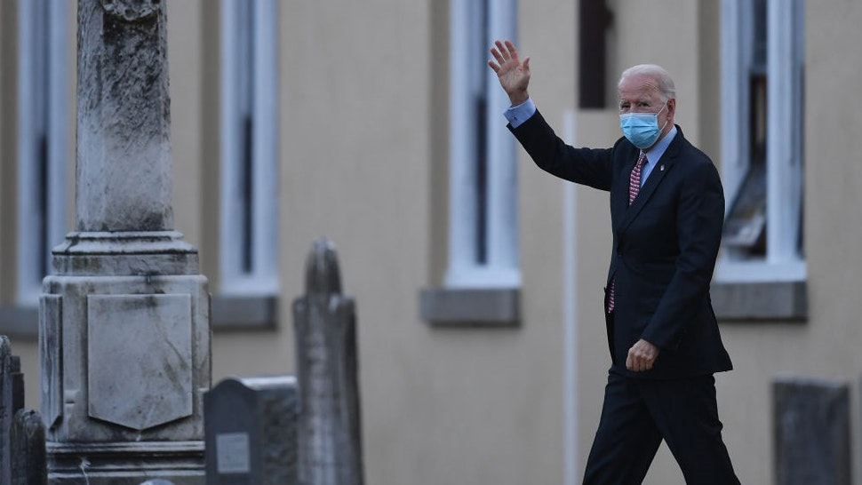 TOPSHOT - US President-elect Joe Biden waves as he leaves St. Joseph on the Brandywine Roman Catholic Church on January 16, 2021 in Wilmington, Delaware. - President-elect Joe Biden will sign executive orders on Inauguration Day next week to address the pandemic, the ailing US economy, climate change and racial injustice in America, a senior aide said Saturday. (Photo by Angela Weiss / AFP) (Photo by