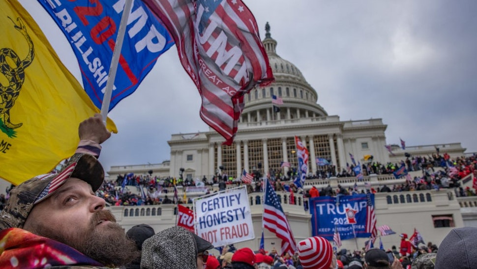 WASHINGTON,DC-JAN6: Supporters of President Trump storm the United States Capitol building. (Photo by