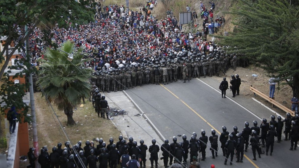 VADO HONDO, GUATEMALA - JANUARY 17: Honduran migrants, part of a caravan heading to the United States, remain in Vado Hondo, Guatemala on January 17, 2021. Guatemalan Army soldiers intervene in migrants. (Photo by