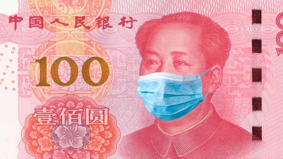 Coronavirus Wuhan. China quarantine, 100 yuan banknote with medical mask. The concept of epidemic and protection against coronavrius.