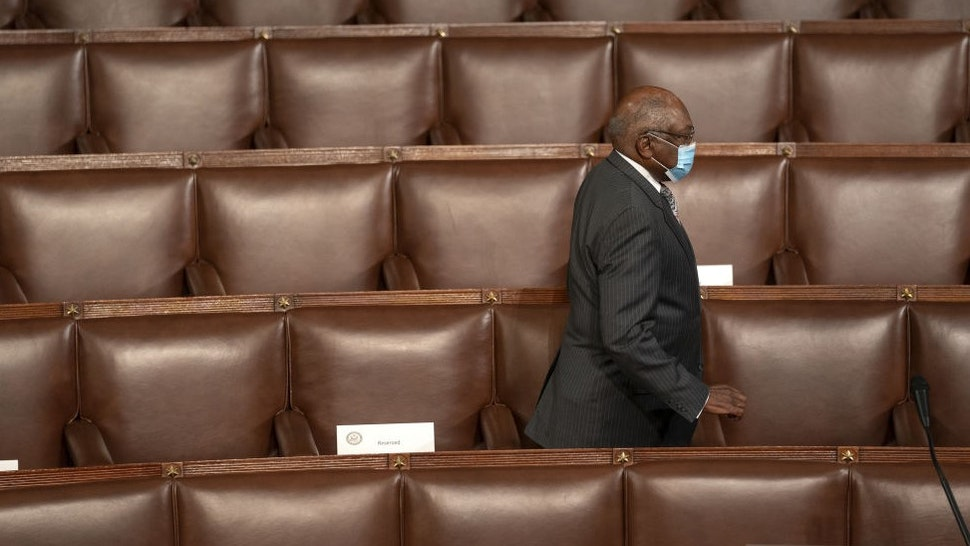 Representative James Clyburn, a Democrat from South Carolina, wears a protective mask while arriving to a joint session of Congress to count the Electoral College votes of the 2020 presidential election in the House Chamber in Washington, D.C., U.S., on Wednesday, Jan. 6, 2021. Congress is meeting to certify Joe Biden as the winner of the 2020 presidential election, with scores of Republican lawmakers preparing to challenge the tally in a number of states during what is normally a largely ceremonial event. Photographer: