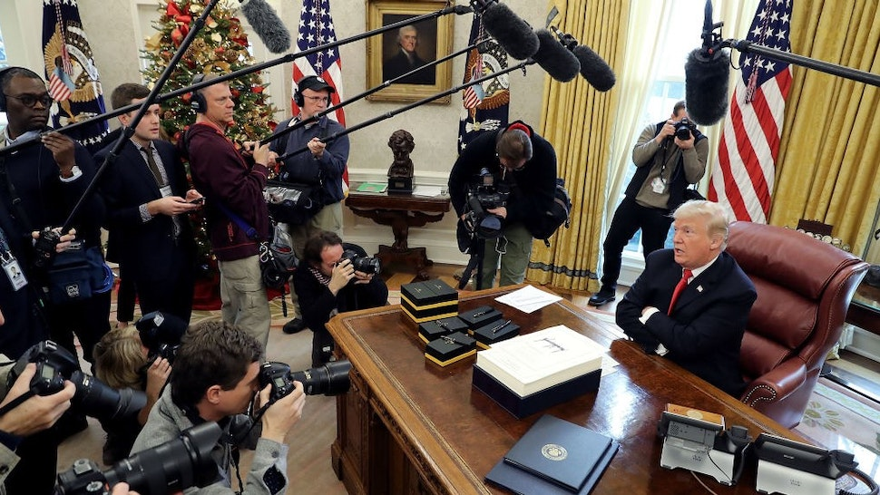 WASHINGTON, DC - DECEMBER 22: U.S. President Donald Trump talks with journalists after signing tax reform legislation in the Oval Office December 22, 2017 in Washington, DC. Trump praised Republican leaders in Congress for all their work on the biggest tax overhaul in decades. (Photo by