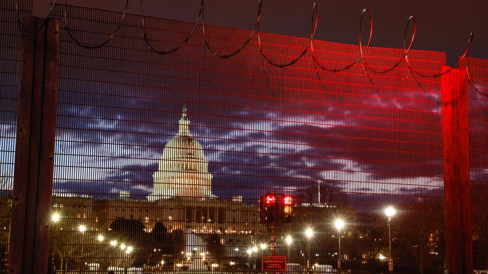 WASHINGTON, DISTRICT OF COLUMBIA, UNITED STATES - 2021/01/23: Razor wire and fences still surround the United States Capitol building at sunrise a few days after the inauguration of President Joe Biden and Vice President Kamala Harris. The Capitol was breached during an insurrection January 6 just days before the inauguration.