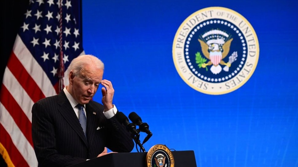"US President Joe Biden answers questions from the media after signing a ""Made in America"" Executive Order in the South Court Auditorium at the White House on January 25, 2021 in Washington, DC. (Photo by JIM WATSON / AFP) (Photo by"