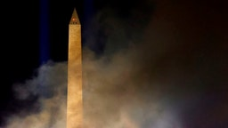 WASHINGTON, DC - JANUARY 20: Smoke lingers in the air around the Washington Monument after a fireworks show during an Inauguration Day event at the Lincoln Memorial on January 20, 2021 in Washington, DC. President Joe Biden and Vice President Kamala Harris were sworn in today. (Photo by