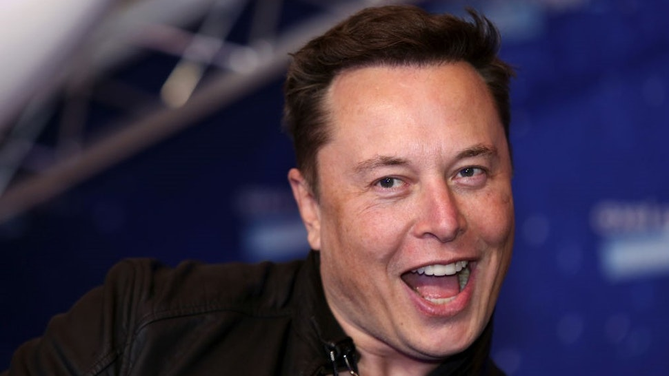 Elon Musk, founder of SpaceX and chief executive officer of Tesla Inc., arrives at the Axel Springer Award ceremony in Berlin, Germany, on Tuesday, Dec. 1, 2020. Tesla Inc.will be added to the S&P 500 Index in one shot on Dec. 21, a move that will ripple through the entire market as money managers adjust their portfolios to make room for shares of the $538 billion company. Photographer: