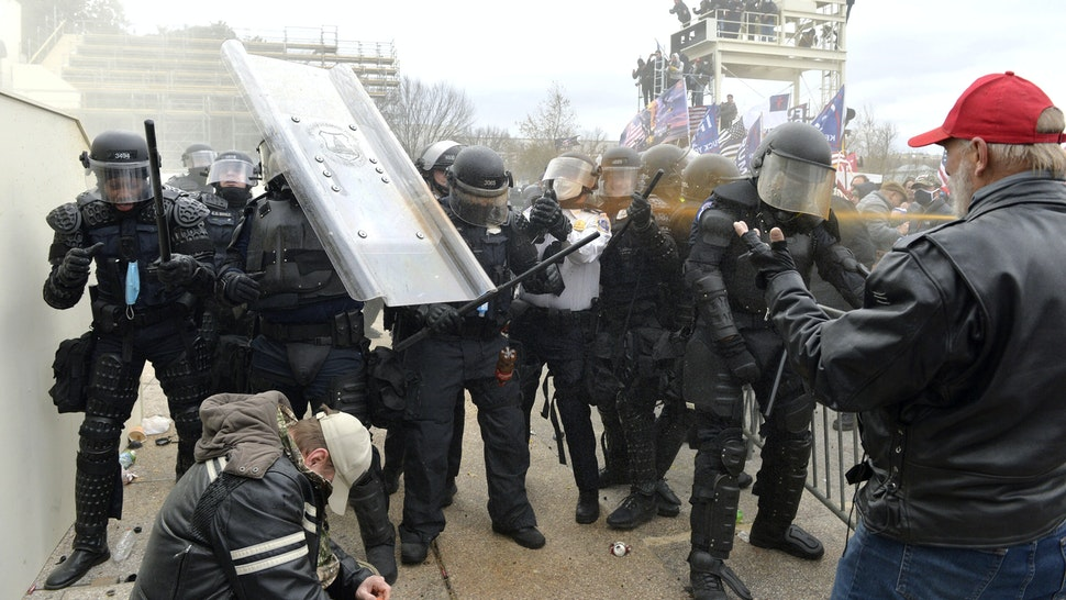 Trump supporters clash with police and security forces as they try to storm the US Capitol in Washington, DC on January 6, 2021. - Demonstrators breeched security and entered the Capitol as Congress debated the a 2020 presidential election Electoral Vote Certification.
