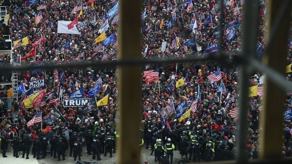 Supporters of US President Donald Trump gather outside the US Capitol's Rotunda on January 6, 2021, in Washington, DC. - Demonstrators breeched security and entered the Capitol as Congress debated the a 2020 presidential election Electoral Vote Certification. (Photo by Olivier DOULIERY / AFP) (Photo by