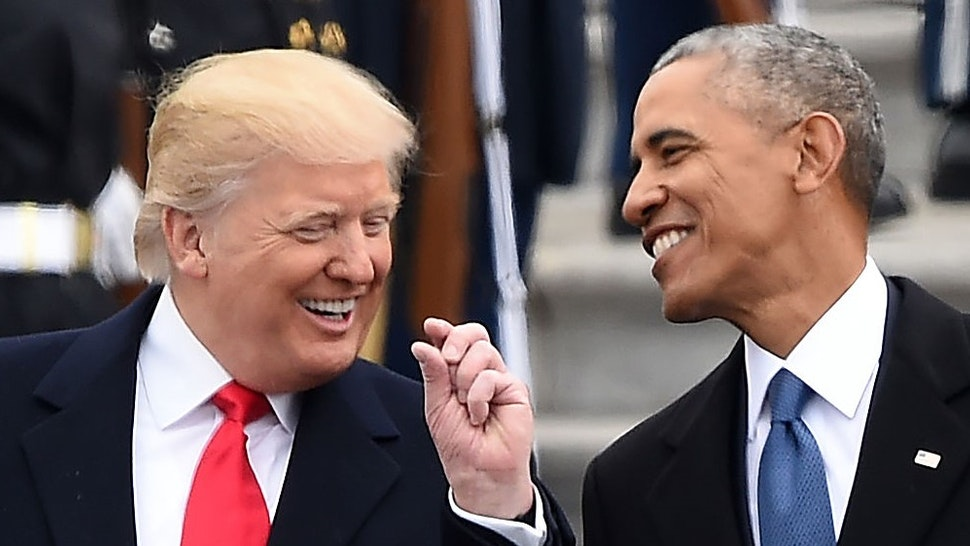 US President Donald Trump and former President Barack Obama talk on the East steps of the US Capitol after inauguration ceremonies on January 20, 2017, in Washington, DC. / AFP / Robyn BECK (Photo credit should read