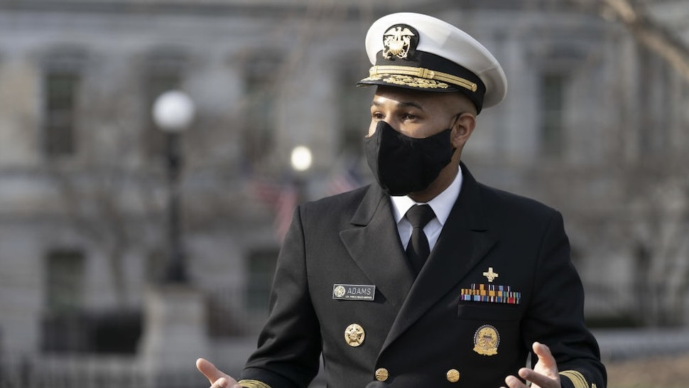 Vice Admiral Jerome Adams, U.S. Surgeon General, speaks to members of the media outside the White House in Washington, D.C., U.S., on Monday, Dec. 21, 2020. Recent polls have shown that confidence in the Covid-19 vaccine is increasing but that many Americans still harbor doubts. Photographer: Chris Kleponis/CNP/Bloomberg