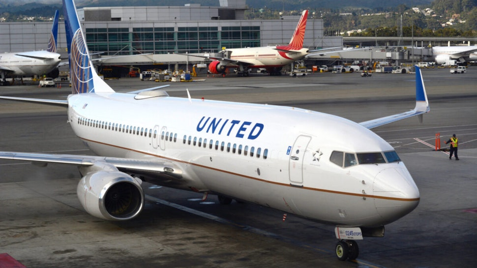 A United Airlines passenger plane approaches a gate at San Francisco International Airport in San Francisco, California.