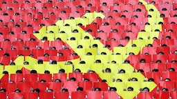Students form a large communist flag during official celebrations held in front of the former southern presidential palace in Ho Chi Minh City 30 April 2005, to mark the 30th anniversary of the end of the Vietnam War.