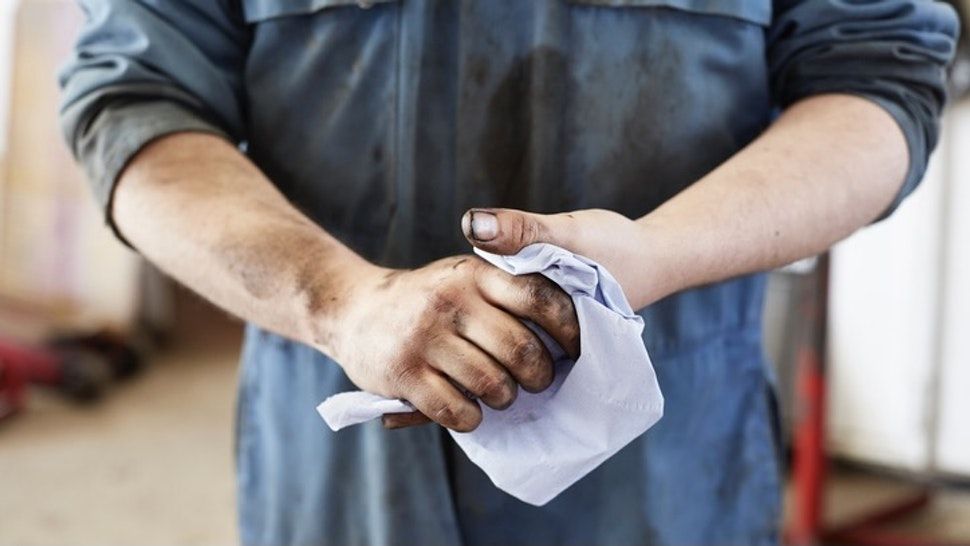 Garage mechanic cleaning hands - stock photo