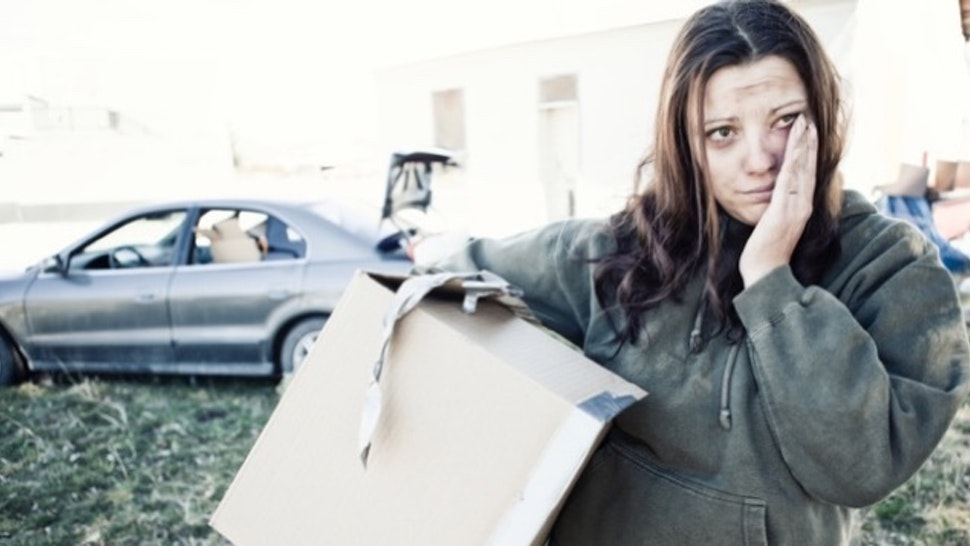 Homeless Woman Living Out of a Car - stock photo