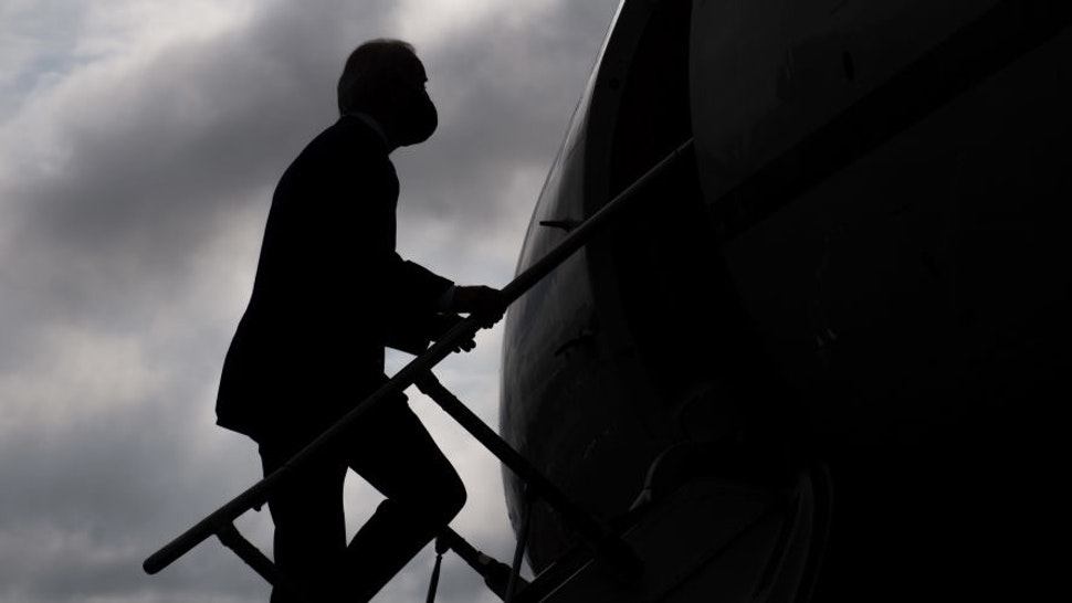 Democratic presidential nominee former US Vice President Joe Biden boards an airplane at Allegheny County Airport in West Mifflin, Pennsylvania, August 31, 2020, following travel to Pennsylvania for campaign events. (Photo by SAUL LOEB / AFP) (Photo by SAUL LOEB/AFP via Getty Images)
