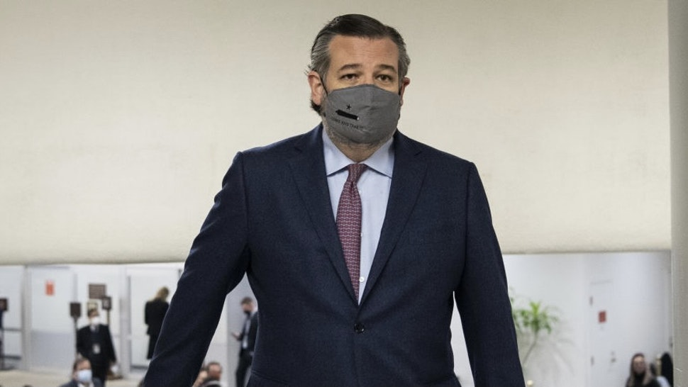 Senator Ted Cruz, a Republican from Texas, walks through the Senate subway at the U.S. Capitol in Washington, D.C., U.S., on Tuesday, Feb. 9, 2021. The Senate begins Donald Trump's second impeachment trial today with a fight over whether the proceeding is constitutional, as a number of conservative lawyers reject the defense team's claim that a former president can't be convicted of a crime by Congress. Photographer: Caroline Brehman/CQ Roll Call/Bloomberg
