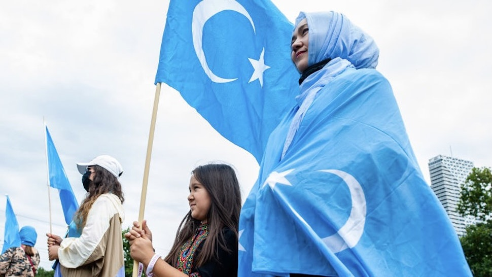 A woman and her daughter are holding Uyghur flags, during the demonstration 'Freedom for Uyghurs' in The Hague, Netherlands on August 20th, 2020. (Photo by Romy Arroyo Fernandez/NurPhoto)