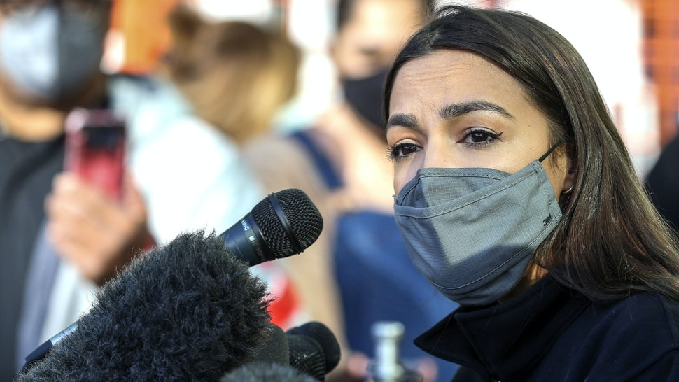 Congresswoman Alexandria Ocasio-Cortez speaks to the media at the Houston Food Bank on February 20, 2021 in Houston, Texas. - The lawmakers address the weather disaster in Texas and helped distribute food at the food bank.