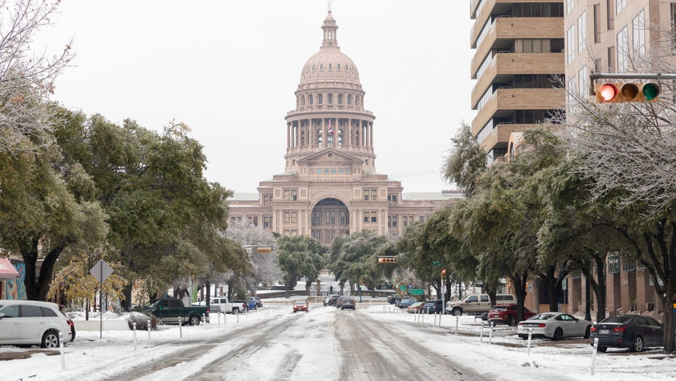 A snow covered road near the Texas State Capitol Building in Austin, Texas, U.S., on Wednesday, Feb. 17, 2021. The crisis that has knocked out power for days to millions of homes and businesses in Texas and across the central U.S. is getting worse, with blackouts expected to last until at least Thursday.