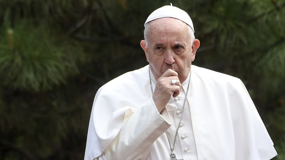 Pope Francis coughs as he is welcomed by Macedonia's President during a welcome ceremony in the courtyard of the presidential palace in Skopje on May 7, 2019. - The three-day tour, which also takes in North Macedonia, includes a visit to a refugee camp on the outskirts of Sofia and a commemoration of Mother Teresa, the most famous native of the Macedonian capital Skopje. Like Bulgaria, the pope's first stop on his three-day Balkan tour, North Macedonia is mainly Orthodox Christian, a church Francis is keen to improve relations with. Ahead of his visit, Francis praised the mix of cultures, religions and ethnicities in a country that sits at the cross-roads of the East and West. (Photo by Robert ATANASOVSKI / AFP) (Photo by ROBERT ATANASOVSKI/AFP via Getty Images)