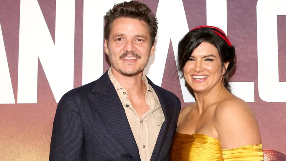 """HOLLYWOOD, CALIFORNIA - NOVEMBER 13: Pedro Pascal and Gina Carano arrive at the premiere of Lucasfilm's first-ever, live-action series, """"The Mandalorian,"""" at the El Capitan Theatre in Hollywood, Calif. on November 13, 2019. """"The Mandalorian"""" streams exclusively on Disney+."""