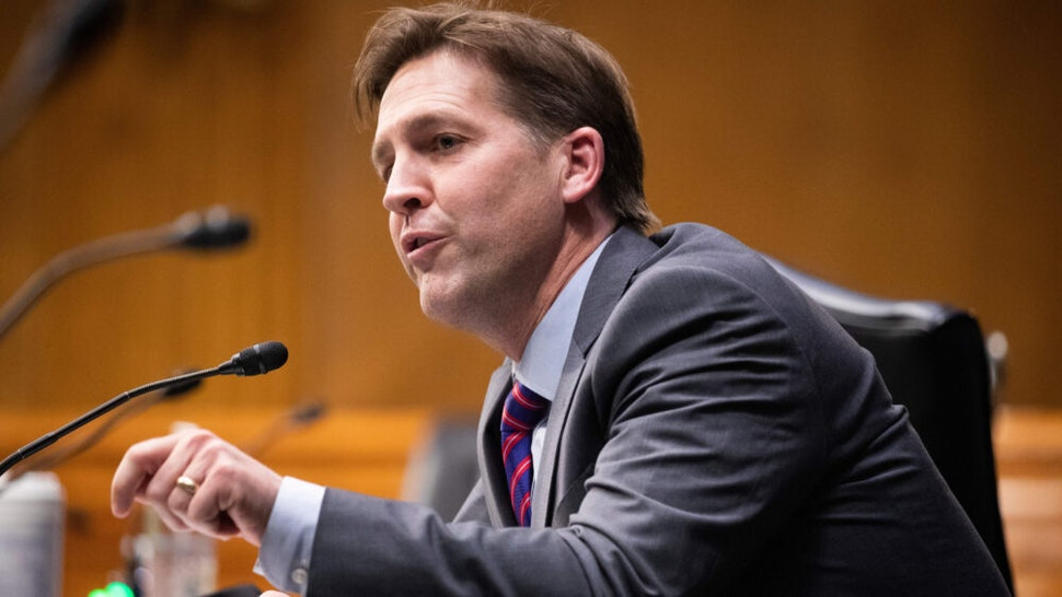 Republican Senator of Nebraska Ben Sasse directs a question toward Xavier Becerra during the Senate Finance Committee hearing on Becerra's nomination to be secretary of Health and Human Services (HHS), on Capitol Hill in Washington, DC, February 24, 2021. - If confirmed, Becerra would be the first Latino secretary of HHS.