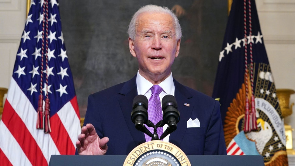 US President Joe Biden speaks on Covid-19 response in the State Dining Room of the White House in Washington, DC on January 26, 2021. - The number of confirmed coronavirus cases around the world on January 26 passed 100 million since the start of the pandemic, according to an AFP tally.