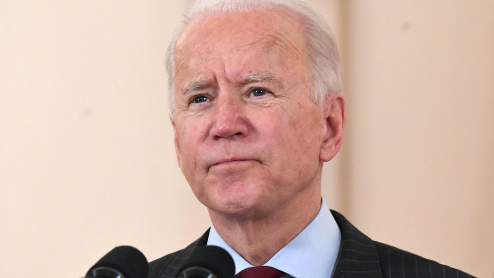 """US President Joe Biden speaks about lives lost to Covid after death toll passed 500,000, in the Cross Hall of the White House in Washington, DC, February 22, 2021. - President Joe Biden called the milestone of more than 500,000 US deaths from Covid-19 """"heartbreaking"""" on Monday and urged the country to unite against the pandemic. """"I know what it's like,"""" an emotional Biden said in a national television address, referring to his own long history of family tragedies."""