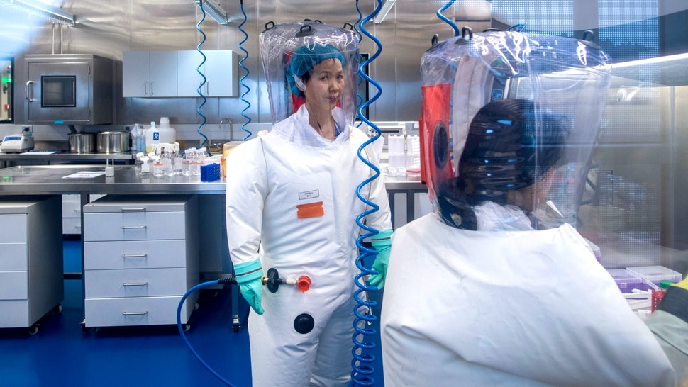 Chinese virologist Shi Zhengli (L) is seen inside the P4 laboratory in Wuhan, capital of China's Hubei province on February 23, 2017. - The P4 epidemiological laboratory was built in co-operation with French bio-industrial firm Institut Merieux and the Chinese Academy of Sciences.