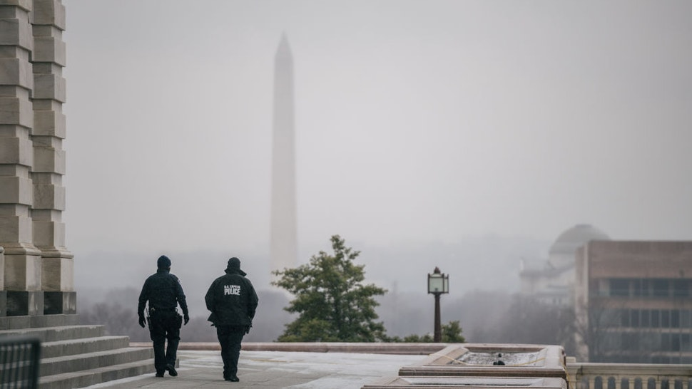 WASHINGTON, DC - FEBRUARY 13: Capitol Police officers patrol the U.S. Capitol grounds following the conclusion of the second impeachment trial of former President Donald Trump on February 13, 2021 in Washington, DC. The Senate voted 57-43 to acquit Trump.