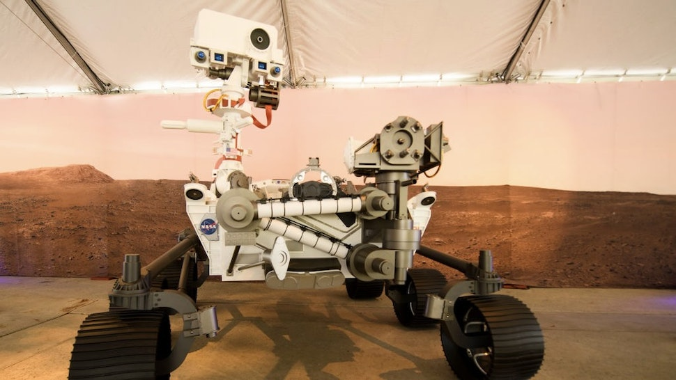 A full scale model of the Mars 2020 Perseverance rover is displayed at NASA's Jet Propulsion Laboratory (JPL) on February 16, 2021 in Pasadena, California. - The Mars exploration rover will search for signs of ancient microbial life and collect rock samples for future return to Earth to study the red planet's geology and climate, paving the way for human exploration. Perseverance also carries the experimental Ingenuity Mars Helicopter - which will attempt the first powered, controlled flight on another planet. (Photo by Patrick T. FALLON / AFP) (Photo by PATRICK T. FALLON/AFP via Getty Images)
