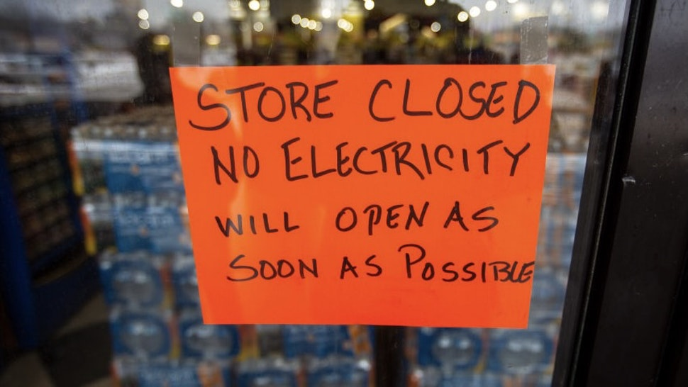AUSTIN, TX - FEBRUARY 17, 2021: A sign states that a Fiesta Mart is closed because of a power outage in Austin, Texas on February 17, 2021. Millions of Texans are still without water and electric as winter storms continue. (Photo by Montinique Monroe/Getty Images)